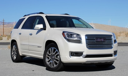 A three-quarter front view of a 2013 GMC Acadia Denali