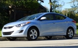 A three-quarter front view of a 2012 Hyundai Elantra GLS