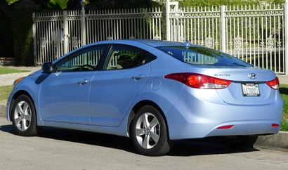 A three-quarter rear view of a 2012 Hyundai Elantra GLS