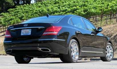 A three-quarter rear view of a black 2011 Hyundai Equus