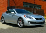 A three-quarter front view of a silver 2011 Hyundai Genesis Coupe 3.8 Track