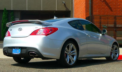 A three-quarter rear view of a 2011 Hyundai Genesis Coupe 3.8 Track