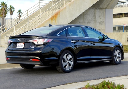 A three-quarter rear view of a 2016 Hyundai Sonata Hybrid sedan, GAYOT's Car of the Month for April 2016