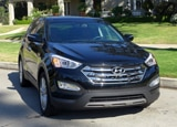 A three-quarter front view of a 2013 Hyundai Santa Fe Sport FWD 2.0T