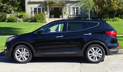 A profile  view of a Hyundai Santa Fe, one of GAYOT's Top 10 Cars for Moms