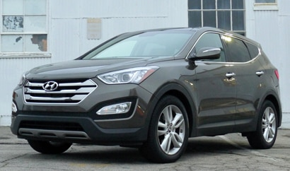 A three-quarter front view of a 2013 Hyundai Santa Fe Sport