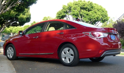 A three-quarter rear view of a 2012 Hyundai Sonata Hybrid, one of our Top 10 Hybrid Cars
