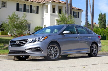 A three-quarter front view of the 2016 Hyundai Sonata Sport 2.0T in shale gray metallic