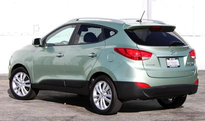 A three-quarter rear view of a 2010 Hyundai Tucson