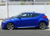 A side view of a 2013 Hyundai Veloster Turbo A/T