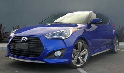 A three-quarter front view of a 2013 Hyundai Veloster Turbo, one of GAYOT's Top 10 Hatchbacks