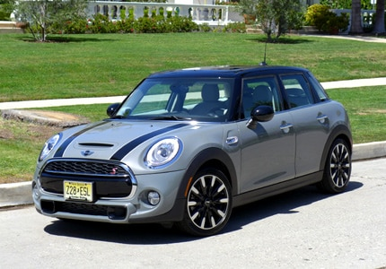 A three-quarter front view of the 2015 Mini Cooper S Hardtop 4-Door, one of GAYOT's Top 10 Hatchbacks