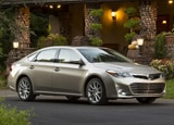 A three-quarter front view of the 2014 Toyota Avalon