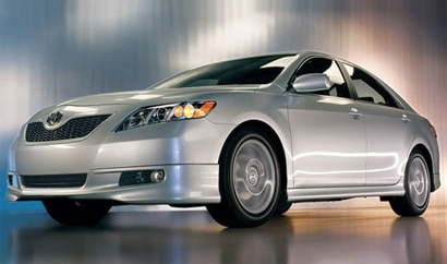 A three-quarter front view of a silver 2009 Toyota Camry
