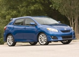 A three-quarter front view of a blue 2010 Toyota Matrix