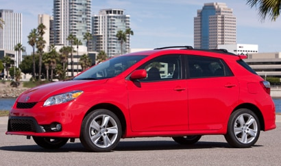 A three-quarter front view of a red 2011 Toyota Matrix