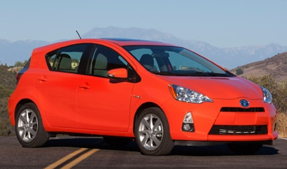 A three-quarter front view of a 2013 Toyota Prius c