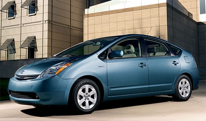 A three-quarter front view of a blue 2008 Toyota Prius