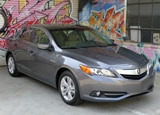 A three-quarter front view of a 2013 Acura ILX Hybrid