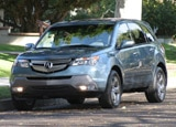 A three-quarter front view of a 2007 Acura MDX