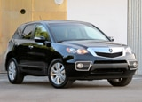 A three-quarter front view of a black 2011 Acura RDX Tech