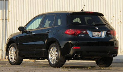 A three-quarter rear view of a black 2011 Acura RDX Tech