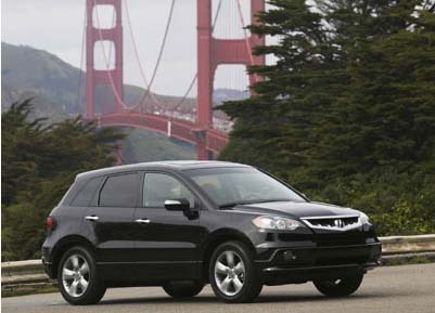 A three-quarter front view of a black 2007 Acura RDX in San Francisco, CA
