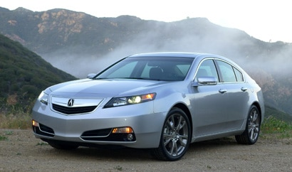 A three-quarter front view of a 2013 Acura TL SH-AWD ADV