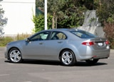 A three-quarter rear view of a 2010 Acura TSX