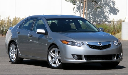 A three-quarter front view of a silver 2011 Acura TSX Tech V6