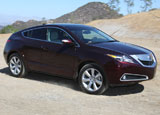 A three-quarter front view of a 2010 dark cherry pearl Acura ZDX