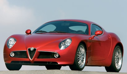 A three-quarter front view of a red 2009 Alfa Romeo 8C Competizione