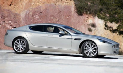 A side view of a silver 2010 Aston Martin Rapide
