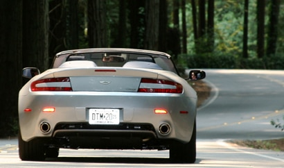 A rear view of a silver 2009 Aston Martin V8 Vantage Roadster
