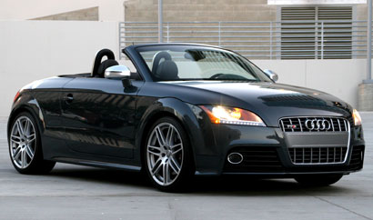 A three-quarter front view of a meteor gray pearl 2009 Audi TTS Roadster