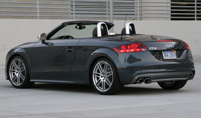 A three-quarter rear view of a 2009 meteor gray pearl Audi TTS Roadster