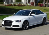 A three-quarter front view of the 2014 Audi A4 2.0T quattro manual