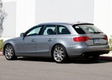 A three-quarter rear view of a silver 2010 Audi A4 Avant