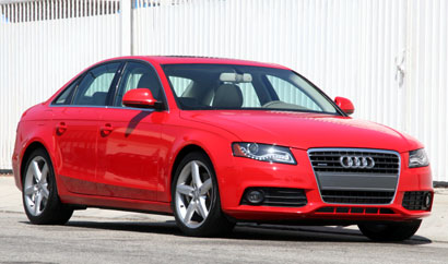 A three-quarter front view of a red 2009 Audi A4 2.0 T quattro