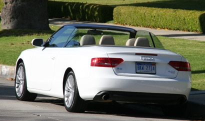 A three-quarter rear view of a white 2010 Audi A5 2.0 TFSI Cabriolet