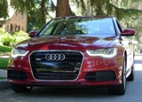 A front view of a red 2012 Audi A6 Quattro