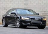 A three-quarter side view of a black 2011 Audi A8