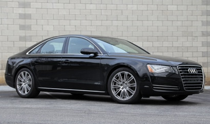 A three-quarter front view of a black 2011 Audi A8