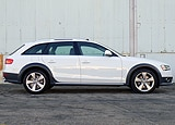 A side view of a white 2013 Audi Allroad