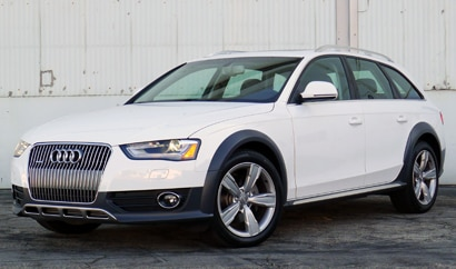 A three-quarter front view of a white 2013 Audi Allroad