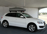 A 2009 Audi Q5 with a cargo carrier under a tent