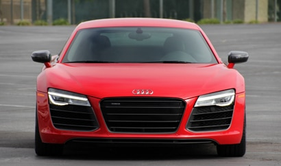 A front view of the 2014 Audi R8 V10 plus Coupe, one of GAYOT's Top 10 Exotic Sports Cars