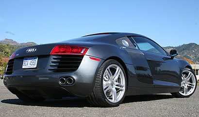 A three-quarter rear view of a black 2008 Audi R8