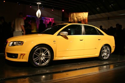 A side view of a yellow 2007 Audi RS 4