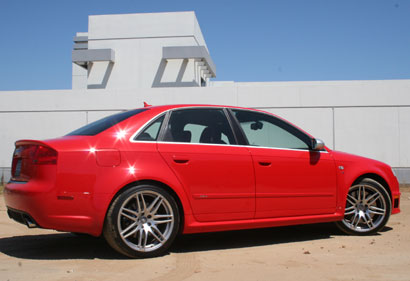 A three-quarter rear view of a red 2007 Audi RS 4